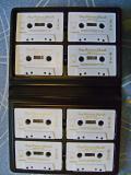 Набор из 8 аудиокассет в футляре.