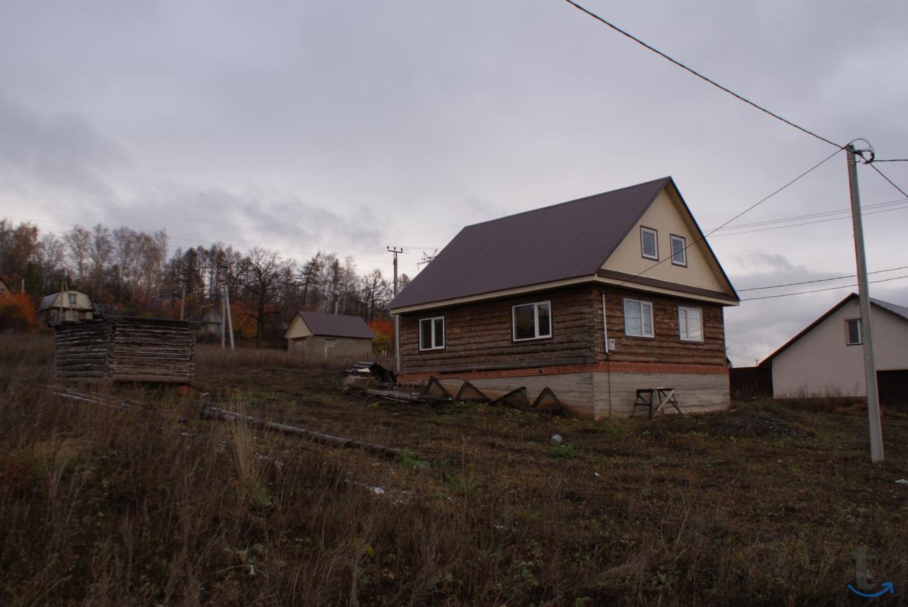 Красивый бревенчатый дом в Юматово