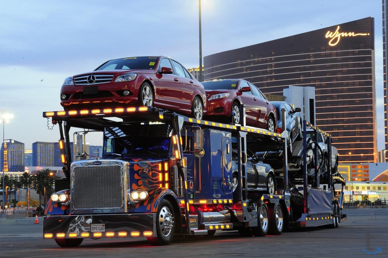 Услуги по перевозке автомобилей ...