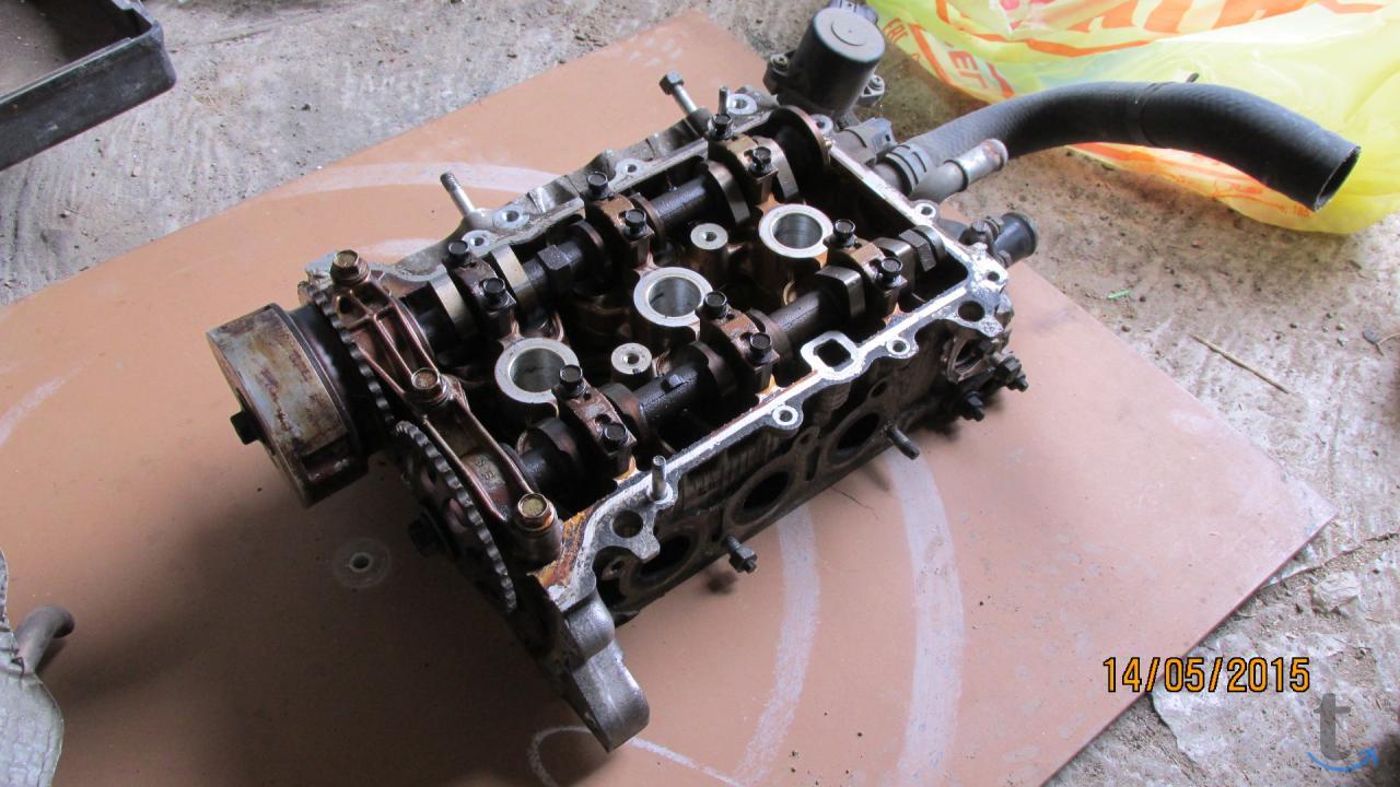 Головка блока от двигателя 1KR-FE