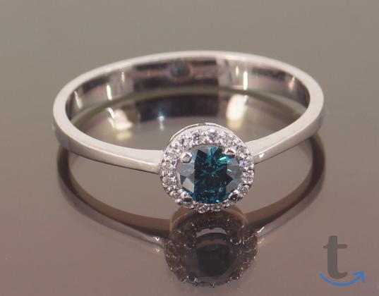Кольцо золотое с голубым и белым...